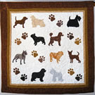 Quilt with differnet sized dogs on it.